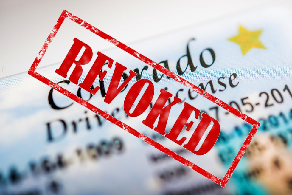 "Colorado driver's license stamped ""revoked"""