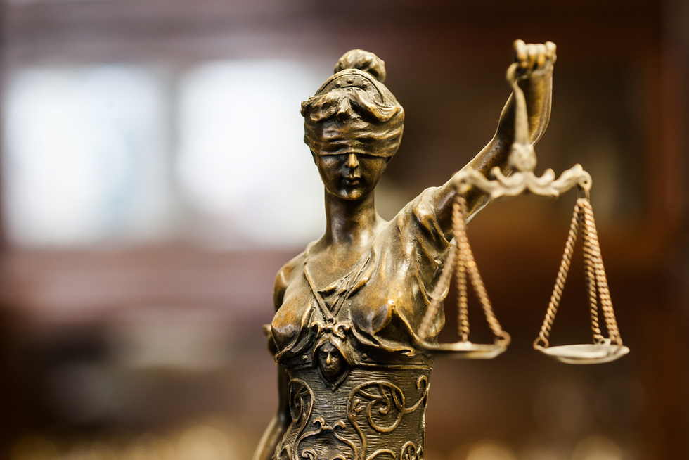 statue of justice blindfolded and holding scales