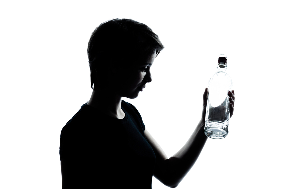 child with bottle of vodka