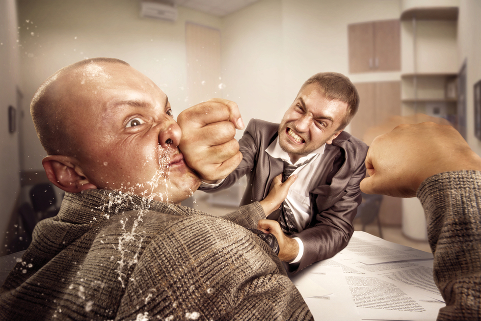 man in suit hitting another man in suit