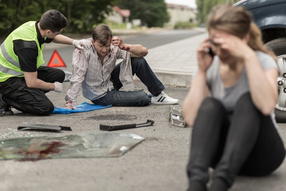 Woman on phone after bad car accident