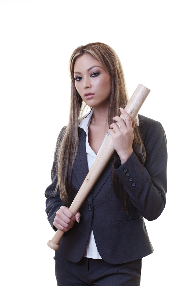 girl holding baseball bat in menacing fashion