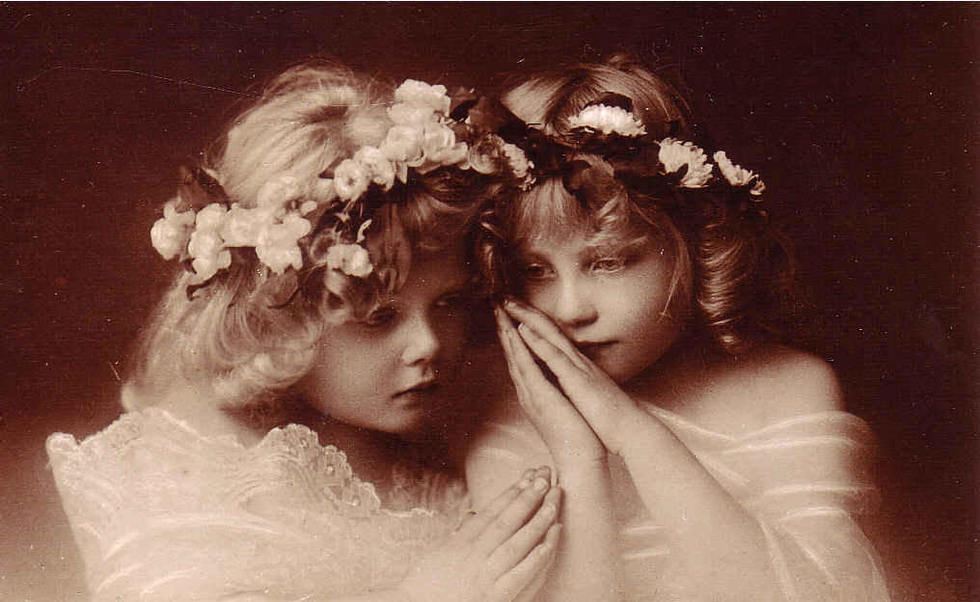 vintage photo of two girls dressed as angels
