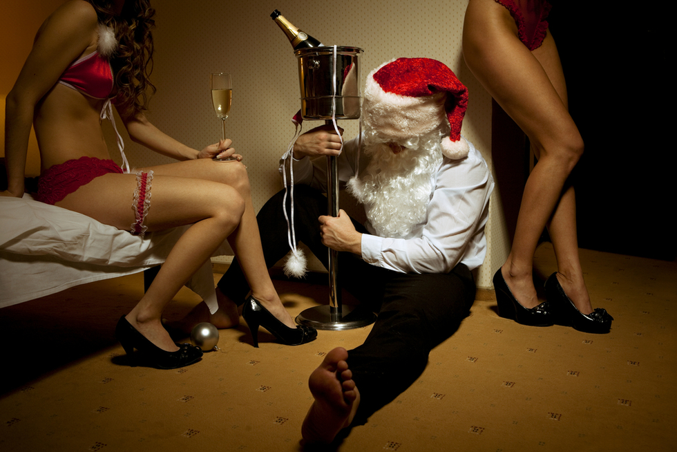 drunk Santa in hotel with two women in red lingerie