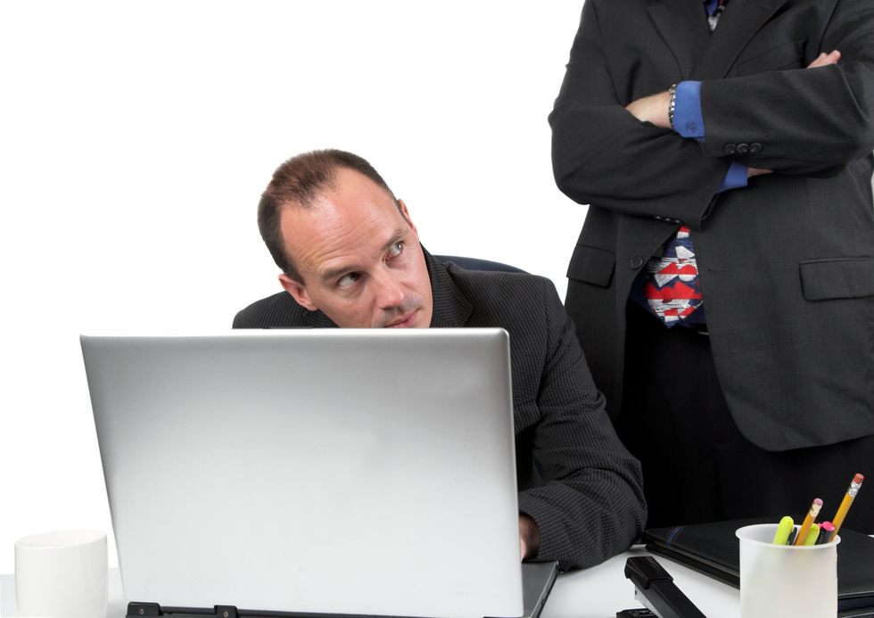 boss catching an employee doing something wrong on a laptop