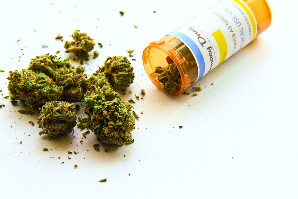 marijuana buds spilling out of prescription bottle