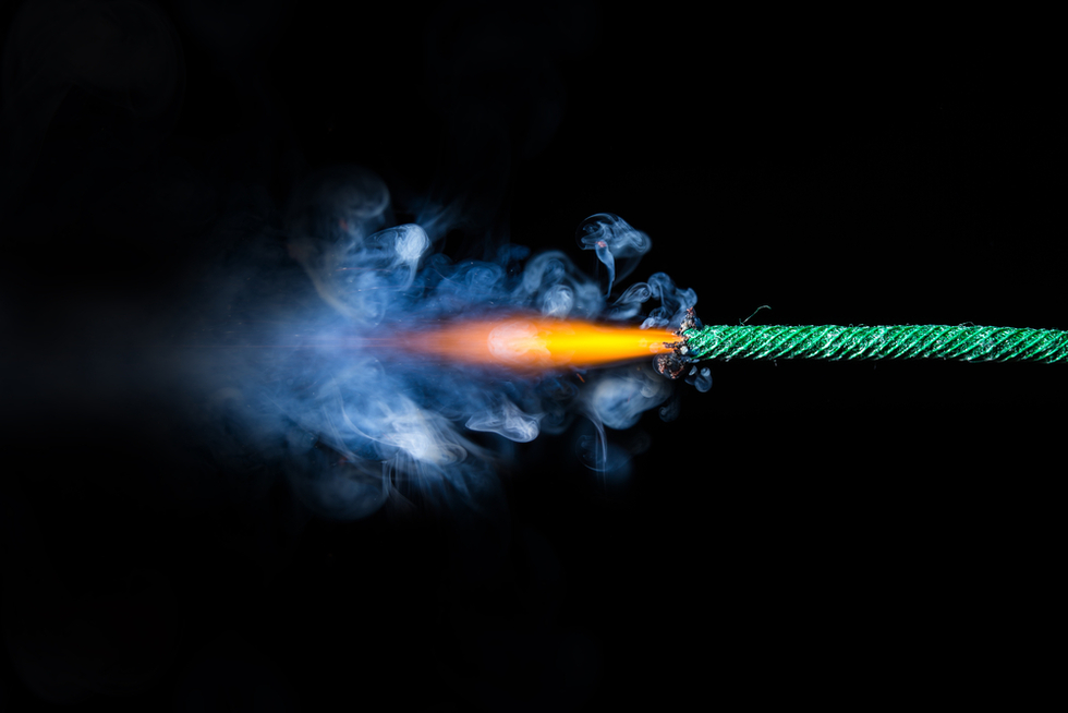 burning dynamite fuse against dark background
