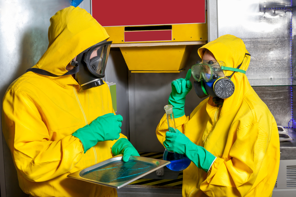 man and woman in yellow protective gear cooking meth