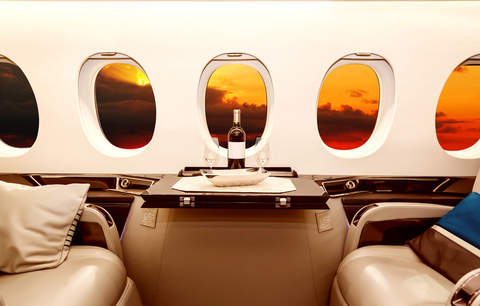 bottle of wine on table in private airplane