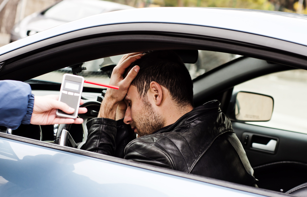 devastated male driver being shown his Breathalyzer result
