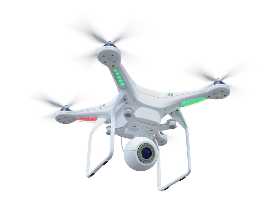 white drone helicopter with camera attached