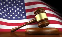 judge's gavel in front of U.S. flag