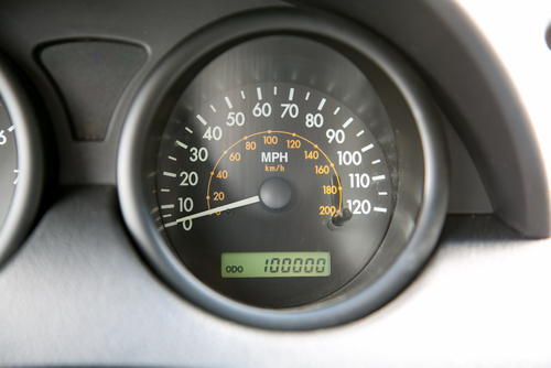 odometer showing 100,000 miles