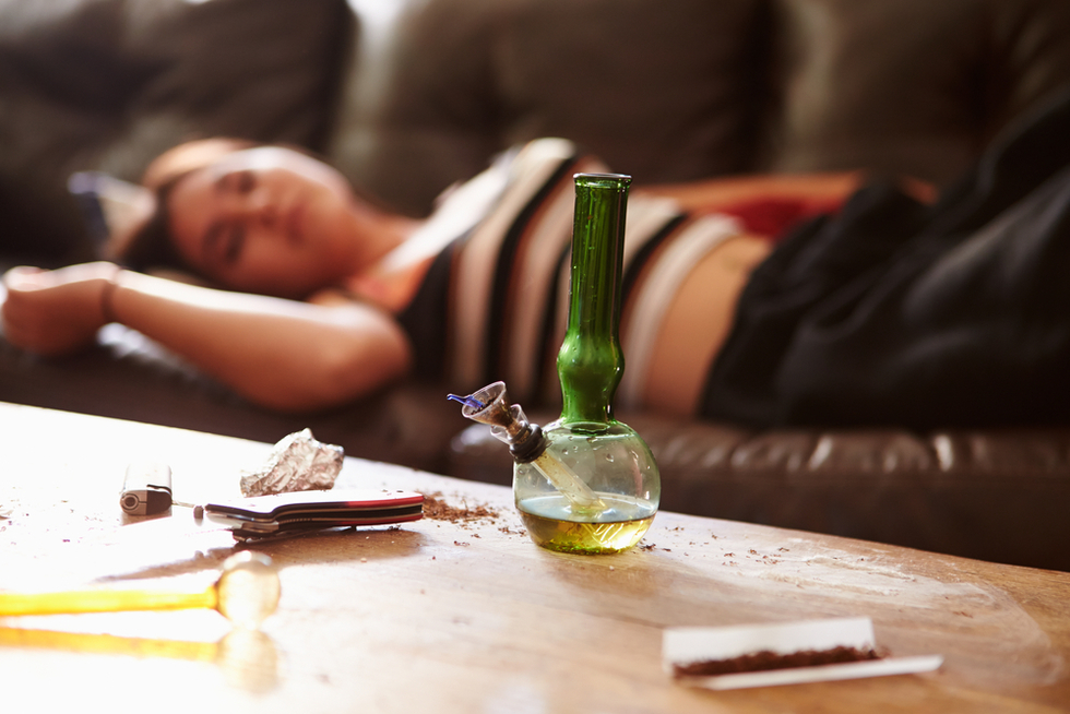 Woman-on-couch-in-background-behind-drug-paraphernalia