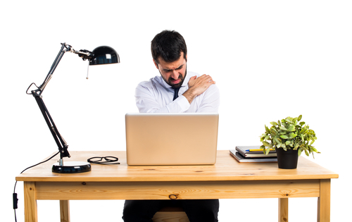businessman in front of computer grabs injured shoulder