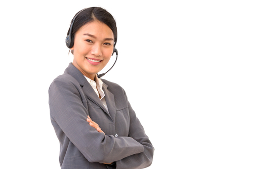 Asian female receptionist with arms crossed