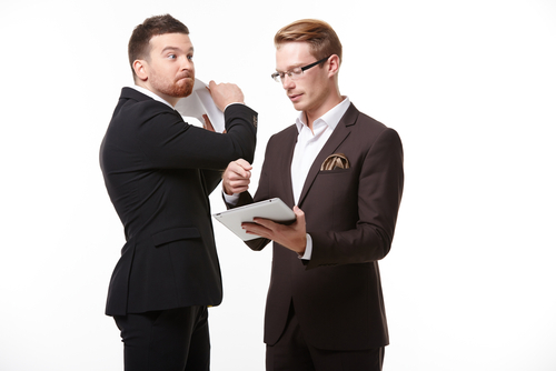 two men in suits arguing