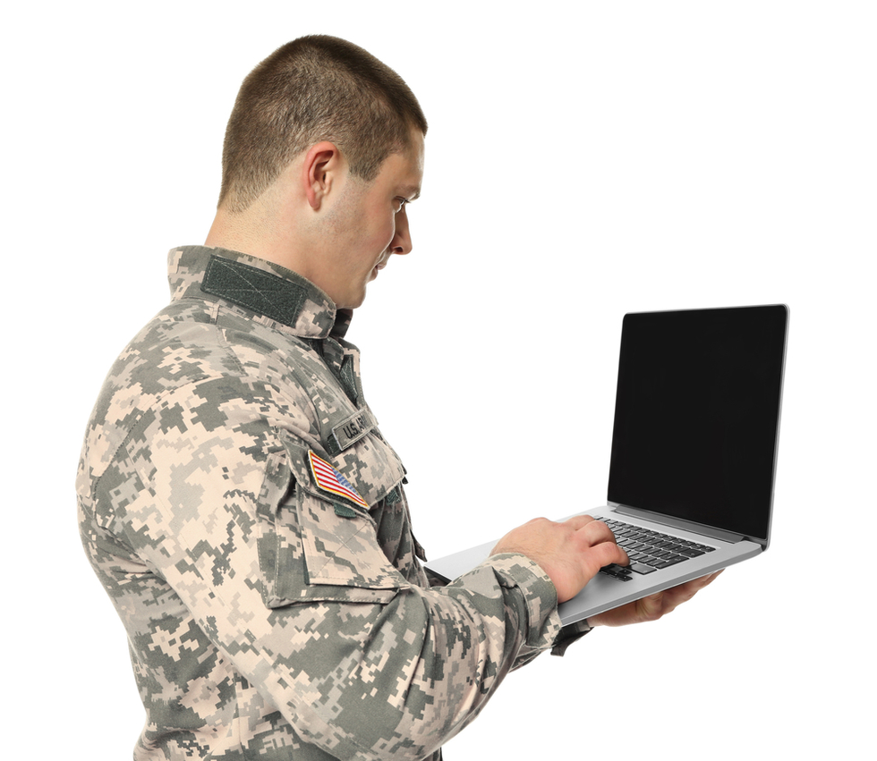 Military-servicemember-holding-laptop