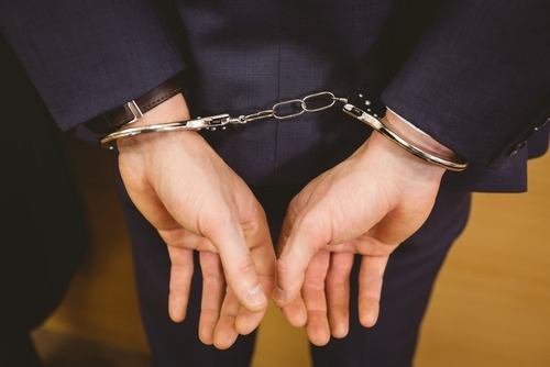 Adult male in handcuffs