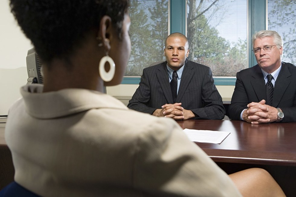 Two-men-interviewing-black-female-job-applicant