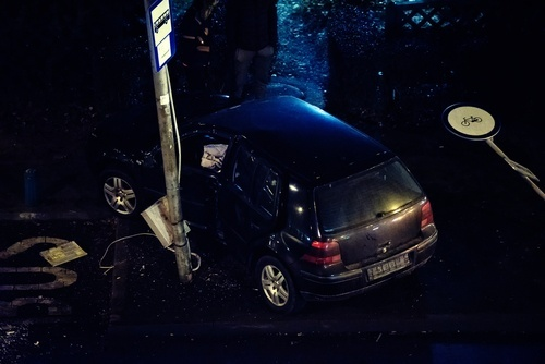 car after crashing into pole at night