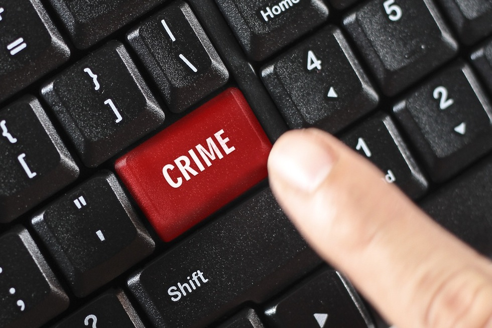 Keyboard-with-crime-button-representing-whistleblowers