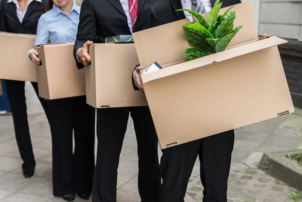 Laid-off-employees-carrying-boxes