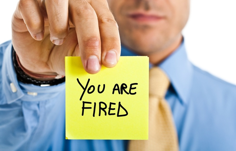 Boss-holding-you're-fired-sign
