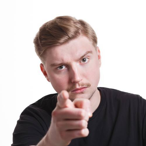 "young man pointing finger in ""shame on you"" gesture"