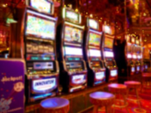 blurred slot machines in casino