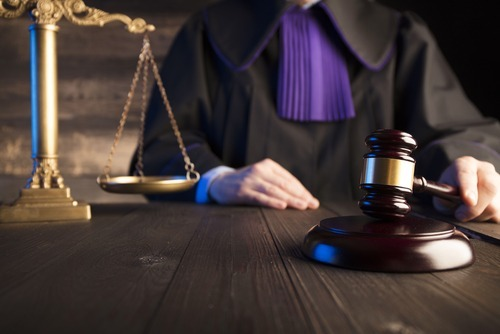 judge in chambers banging gavel on desk