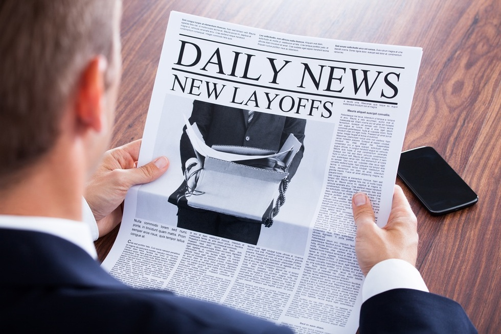 Newspaper-headline-announcing-mass-layoffs