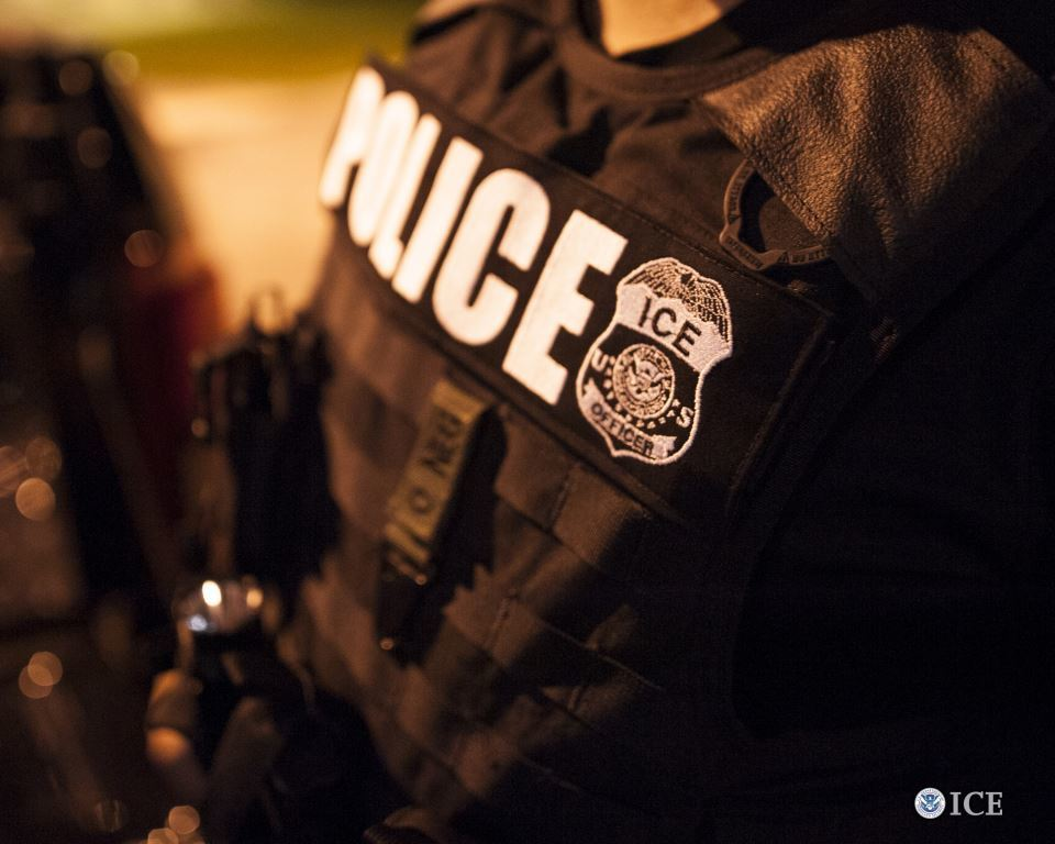 """police officer with patch reading """"ICE"""""""