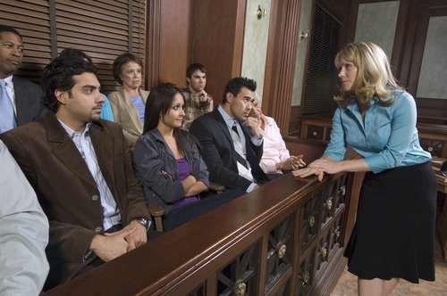 female lawyer making argument to a jury