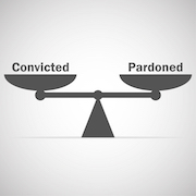 Scale that shows the words convicted and pardoned.