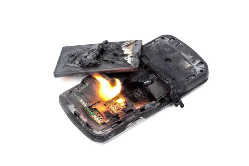 burned cell phone with open battery compartment