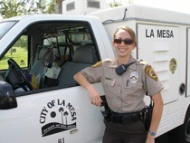 La Mesa, California female animal control officer posing with her official truck