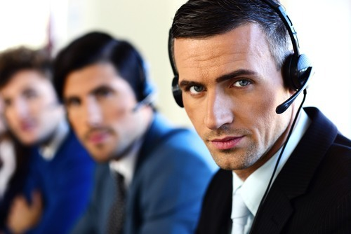 Three receptionists with headsets