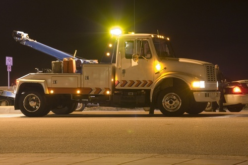 Tow truck about to tow an illegally parked vehicle; California impound laws are codified in 22651 CVC