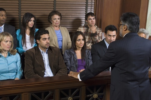 male lawyer speaking to a group of jurors
