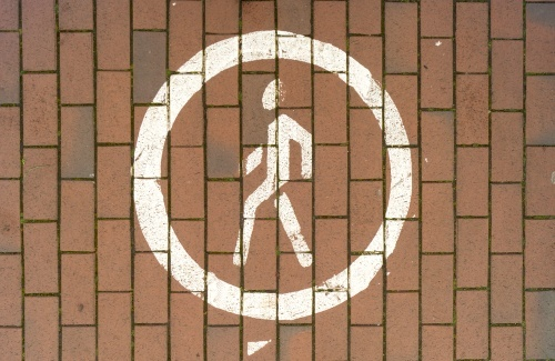 a pedestrian zone sign on the ground