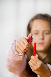 Little girl lighting firecracker