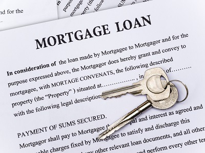 Mortgage loan document with a set of keys on top