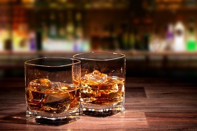 Two glasses with whiskey; loitering to solicit the purchase of alcohol can be a crime under Penal Code 303 a PC