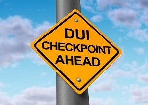 Sign reading DUI checkpoint ahead