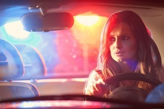 Woman driver being pulled over at night