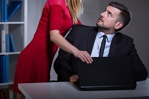 Female worker sexually harassing male colleague