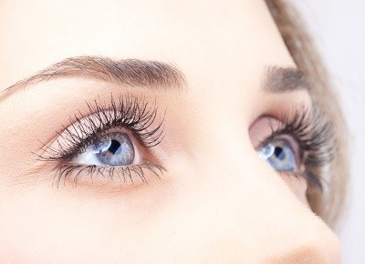 close up woman's eyes with long eyelashes
