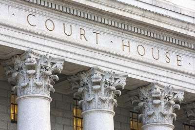 """Plinth reading """"courthouse"""" on top of columns"""
