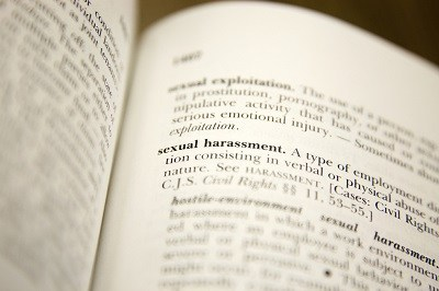 Book showing legal definition of sexual harassment